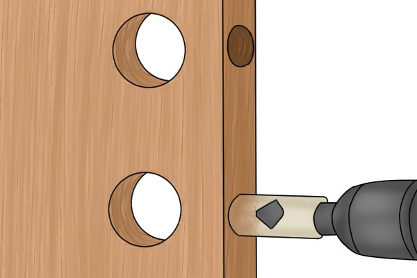 Hole saw, cutting holes in door for dead bolt