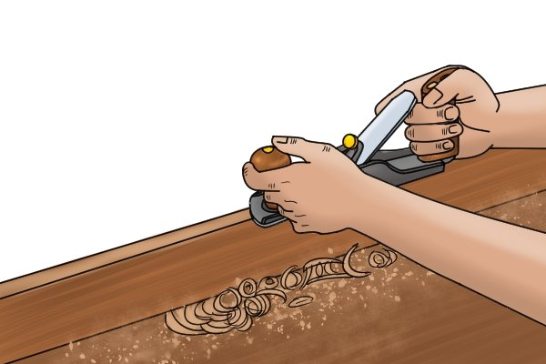 Cabinet maker using a bench plane