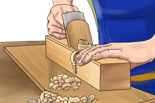 Reducing size of piece of wood with scrub plane