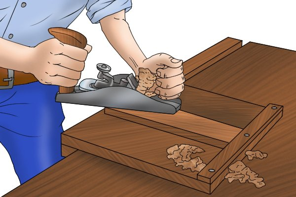 Planing with a woodworking hand plane