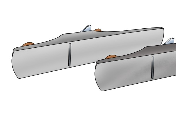 The soles of two metal scrub planes