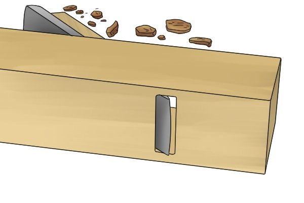 The mouth of a wooden scrub plane