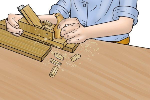 Using a wooden scrub plane