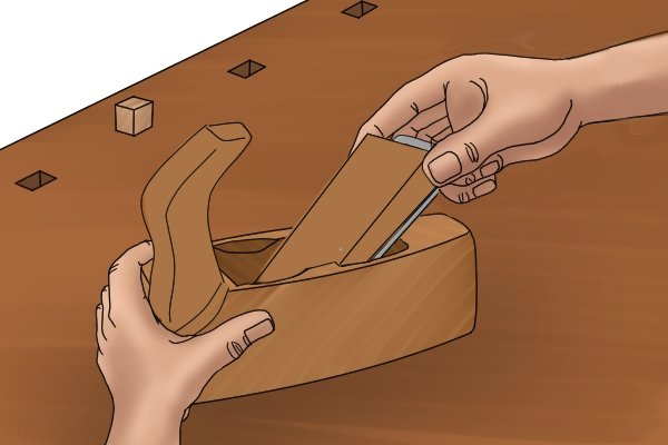 Sliding the wedge into a wooden hand plane