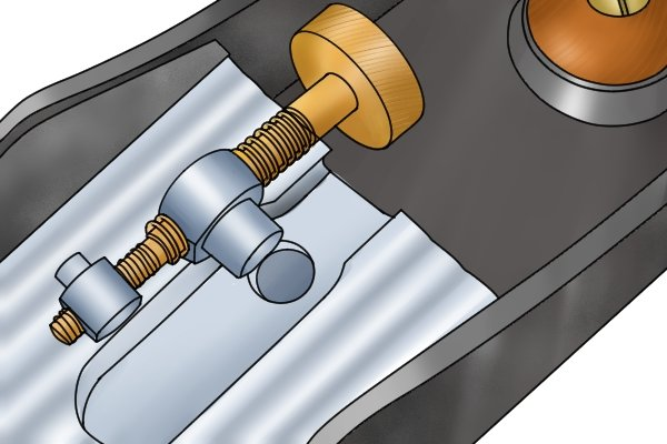 Norris-style adjuster removed from the frog of a low-angle bench plane
