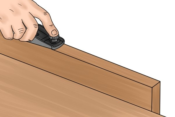 Cutting a chamfer with a block plane