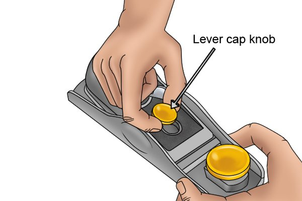 Releasing the lever cap of a block plane