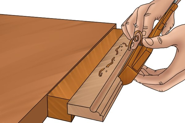 Cutting a traditional moulding with a wooden moulding plane