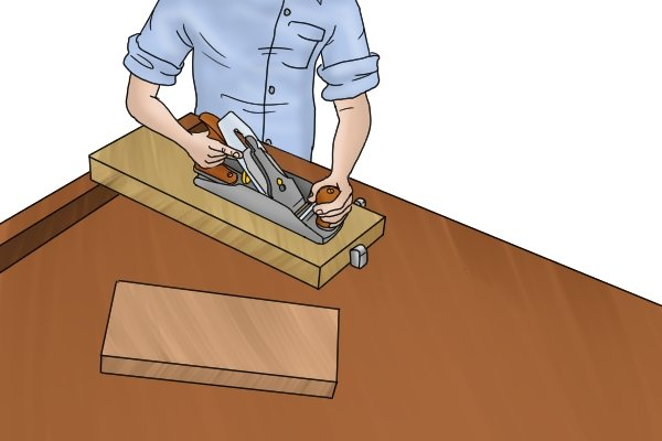 Using a smoothing plane on a piece of wood
