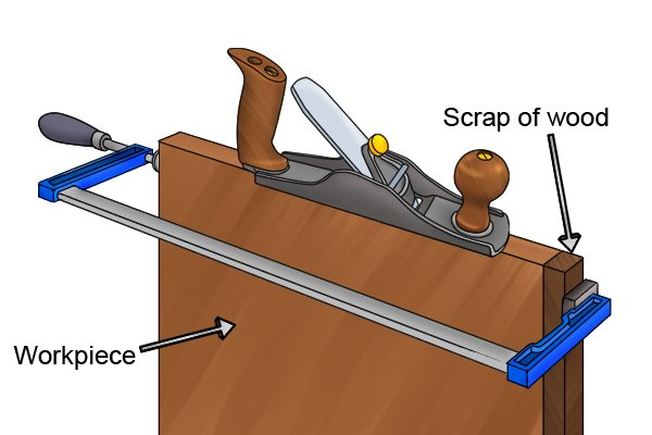 Use a scrap of wood to avoid tear-out