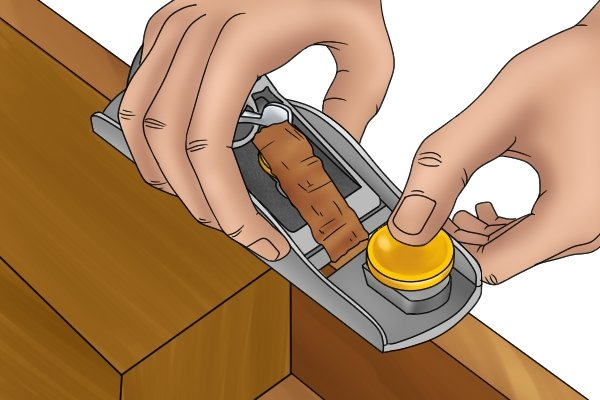 Two-handed planing with a block plane, woodworking hand planes