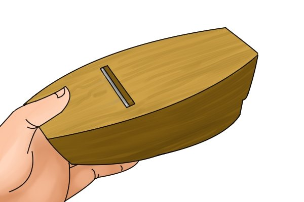 The sole of a wooden block plane