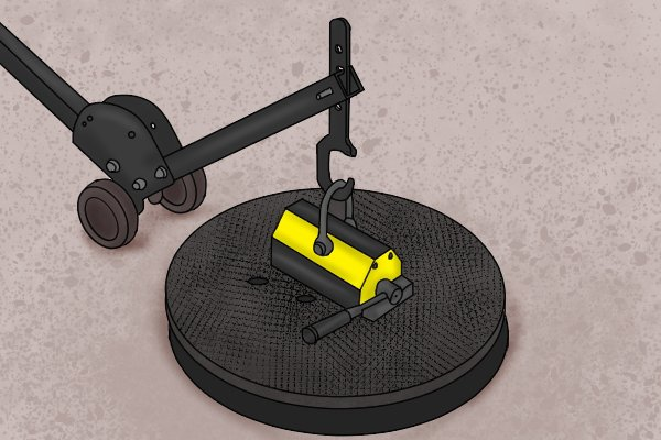 A magnetic manhole lifter lifting a cover needing only one person