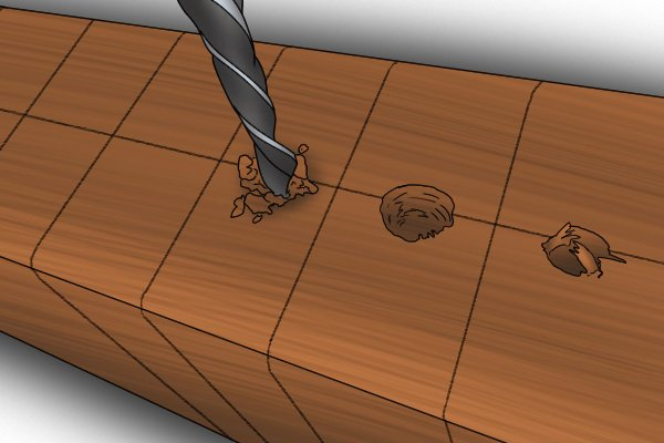 A DIYer using a brad point drill to make holes at carefully measured points along a wooden workpiece to create a dowel joint