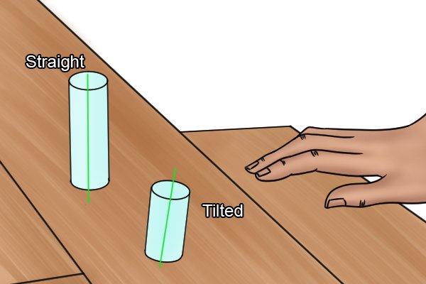 Image showing how a tapered dowel tilts when it is hammered into a drawbored joint
