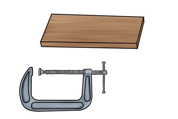 Items required to make a jig on your tool rest: a piece of wood and a clamp
