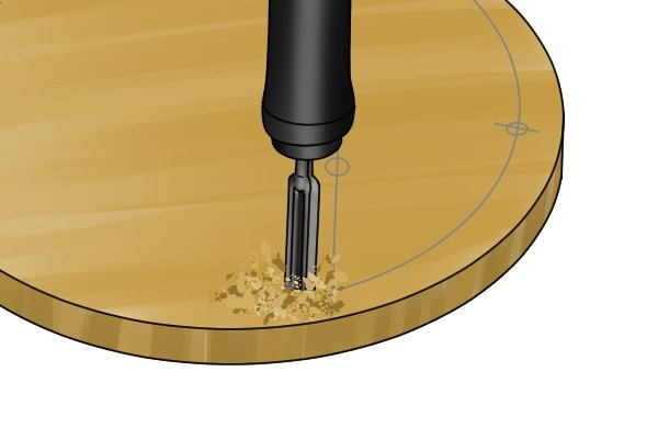 A DIYer seating their spoon bit in a wooden workpiece to make an angled bore hole