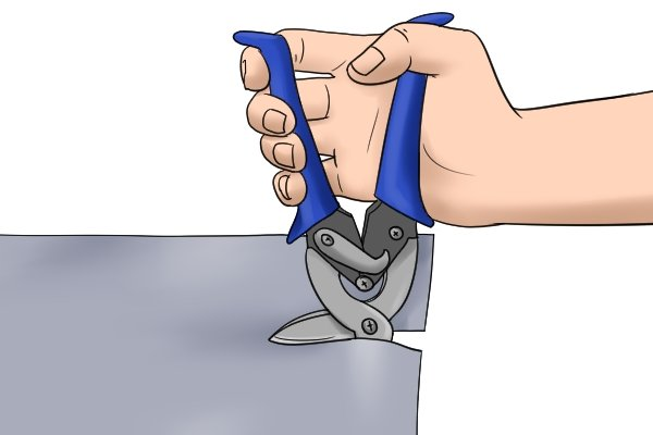 To keep the cut smooth, move aviation shears carefully along the material as you cut