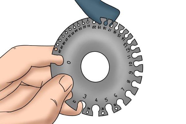 sheet metal being gauge measured