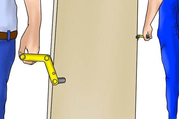 Using a door carrier or board carrier to move sheets of materials makes it much easier than trying to lift it by hand
