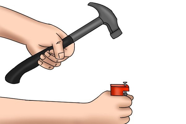 You hit the top of the nail puller with a hammer to push the jaws under the nail head to remove the nail