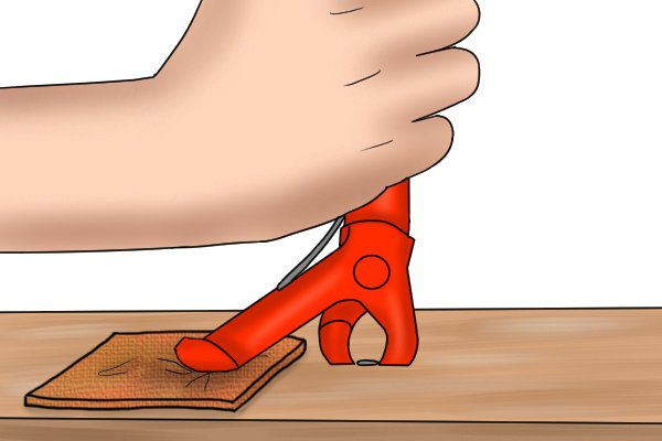 placing something under the base heel of the nail remover will help to limit the damage done to the timber as you remove the nail