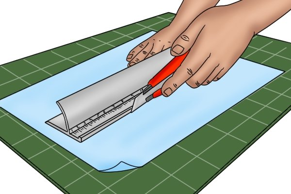 Use a safety rule to safely cut straight lines