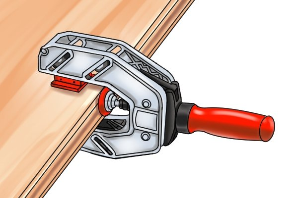 Most edging clamps have tilting jaws to clamp tapered objects