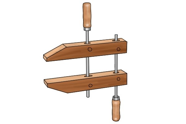 A hand screw clamp is made out of wood
