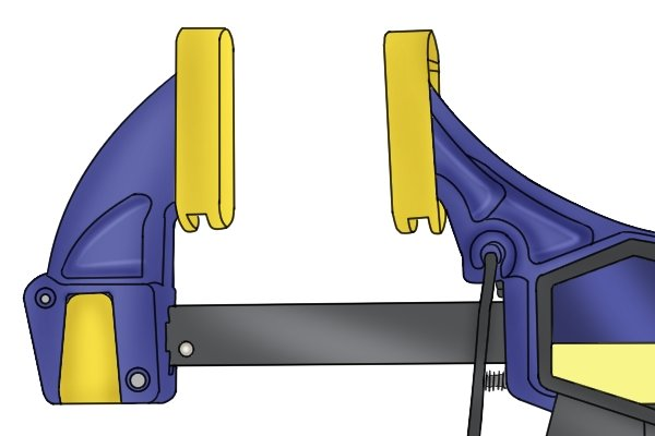 A trigger clamp has a moveable jaw and a fixed jaw