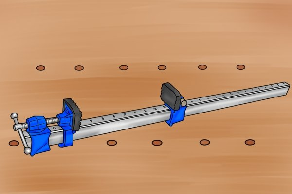 A bar clamp has a long metal bar, usually made from steel or aluminium