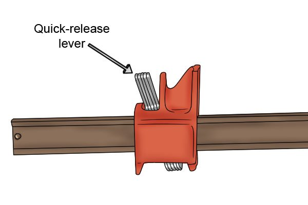Press the quick-release lever down to move the back jaw