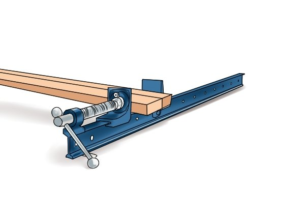 Insert the wood into the bar clamp's jaws