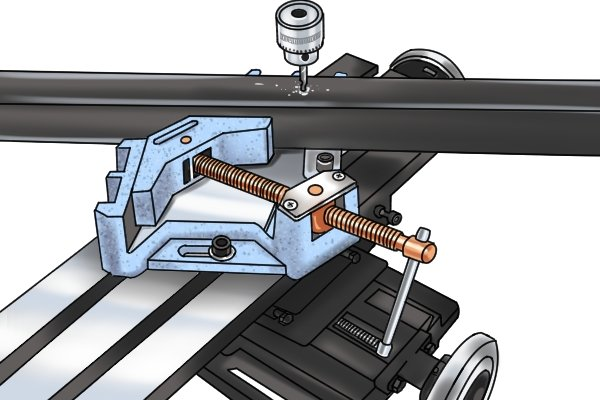 A welding angle clamp can be used on a drill press machine