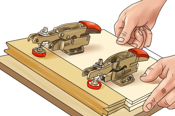 A toogle clamp is commonly used for woodworking
