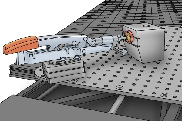 A toggle clamp can push down or push forwards