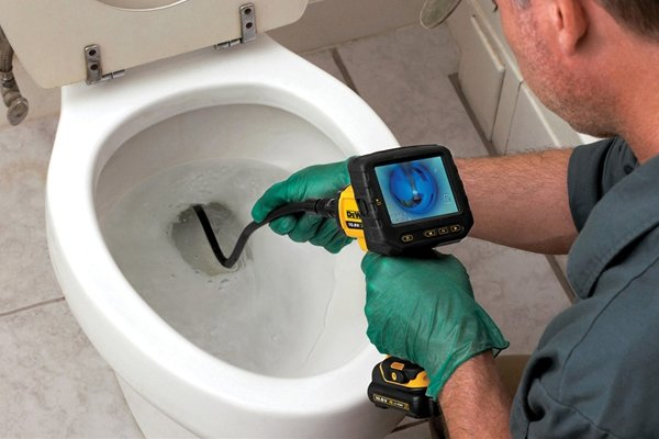 Viewing down the pipe of a toilet with an inspection camera