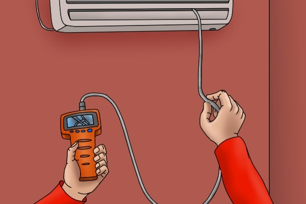 Using an inspection camera to check an air conditioner