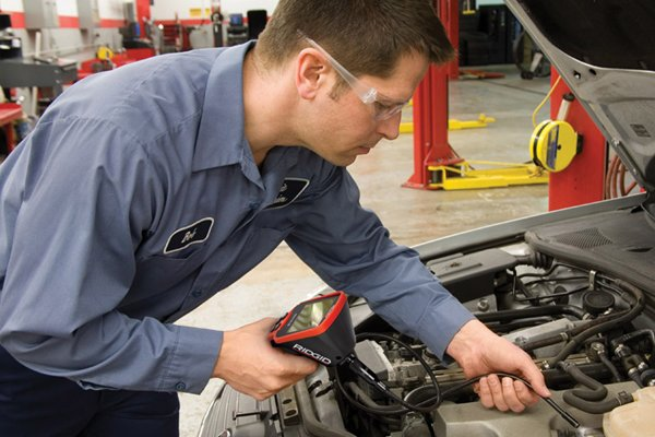 Using an inspection camera to check car parts
