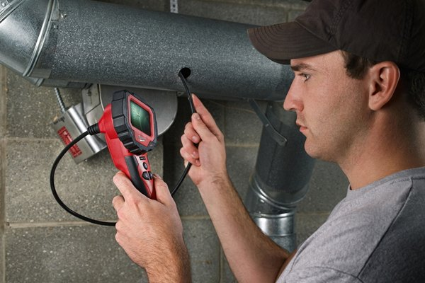 Checking pipes and tubes with an inspection camera