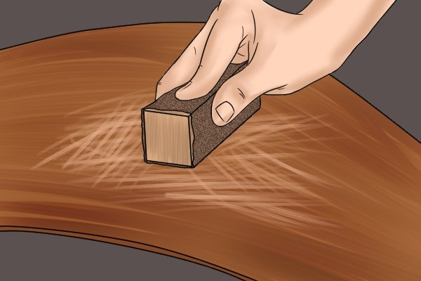 Medium sandpaper can be used to remove varnish from wood