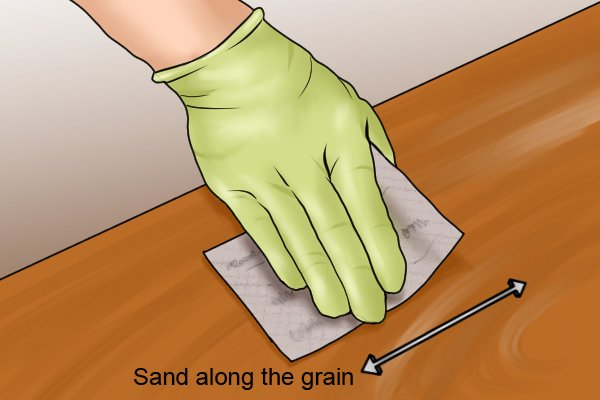Make sure to sand along the grain on wooden surfaces