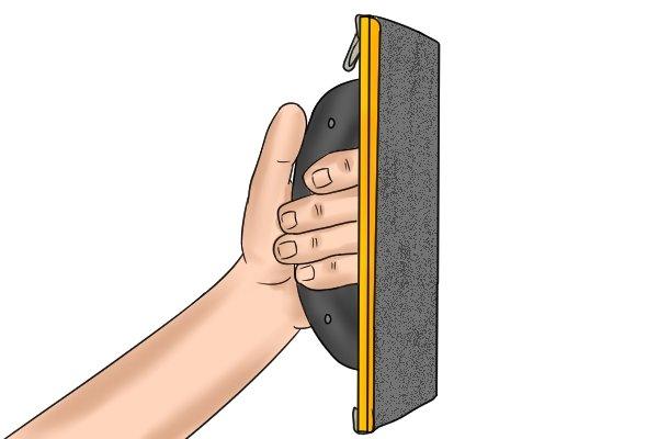 Leave an old piece of sandpaper on your sander