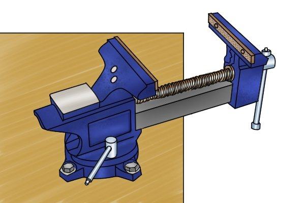 Vice jaws open to place a workpiece between them
