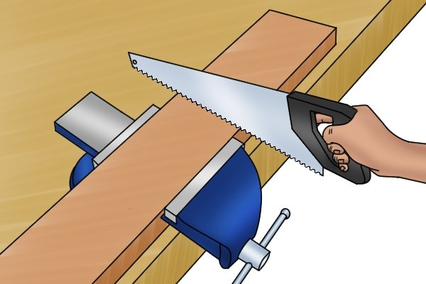 Sawing wood that is clamped in a metalworking vice