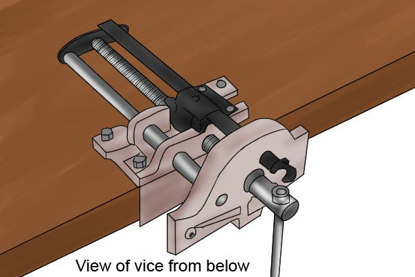 woodworking vice bolted to workbench