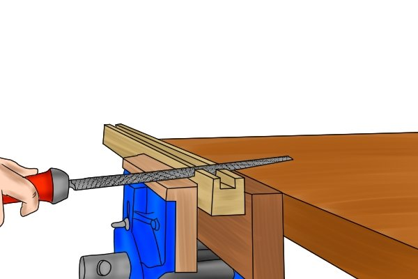 filing with a woodwork vice