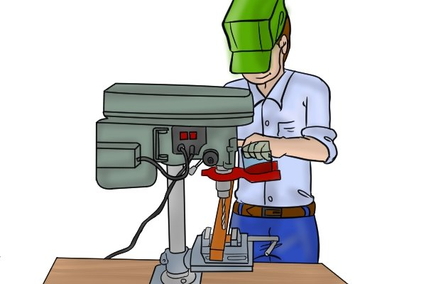 using a drill press machine and vice