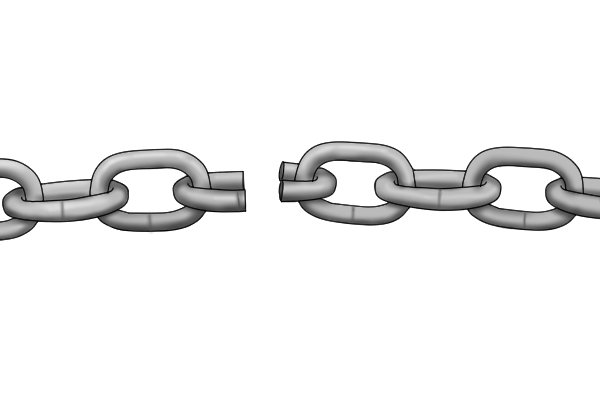 A chain link which has been cut through from two sides, cutting the length cleanly in two.