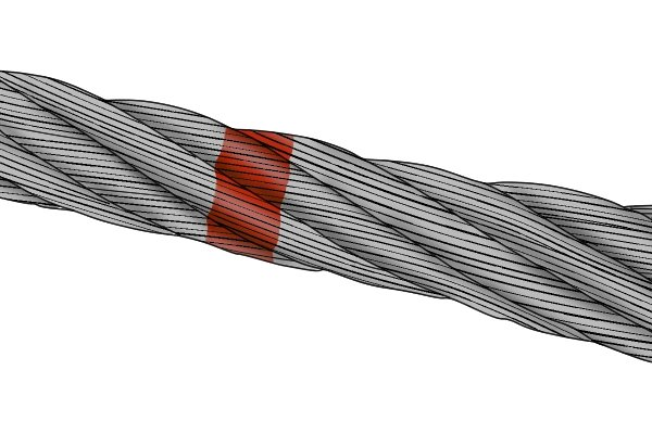 A steel cable with a location marked for cutting with bolt cutters